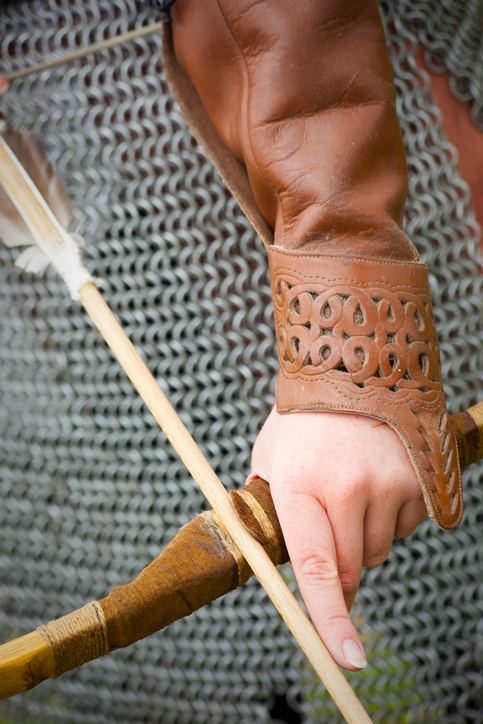 An archer in chainmail with bow drawn.